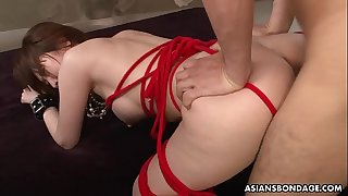 Squirting Asian is roped up and used in a threesome